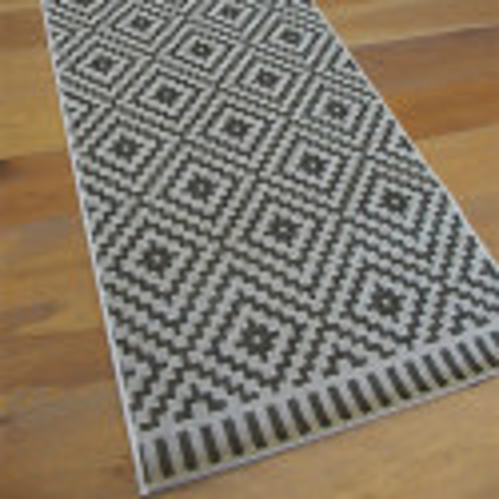 Tapis de cuisine tissé à plat. Motif Ethnic noir et blanc. ESSENZA - 80x200cm.