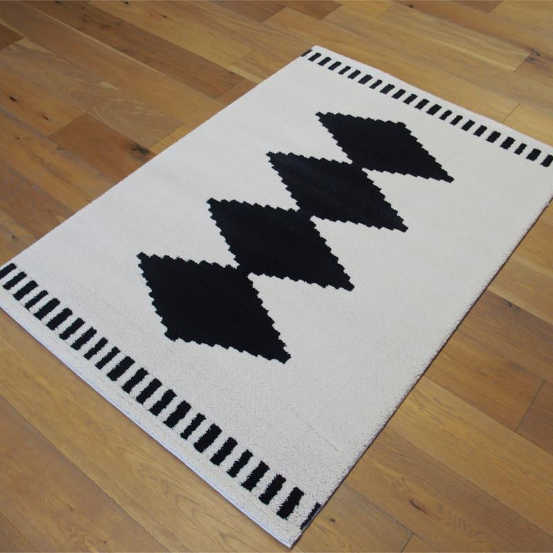 tapis motif ethnique noir et blanc cass 120x170cm alaska. Black Bedroom Furniture Sets. Home Design Ideas