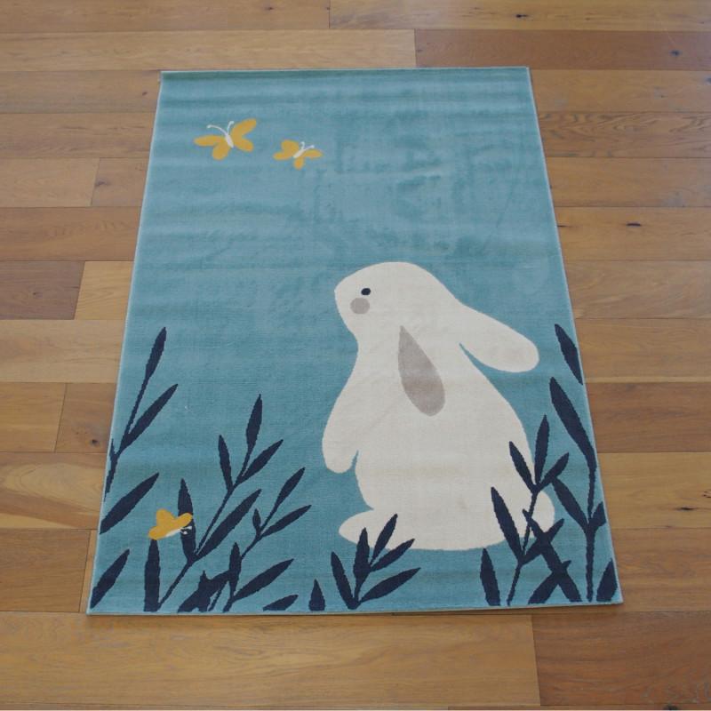 """Tapis enfant """"Lapin et Papillons bleu clair"""" - Canvas BALTA 120x170"""