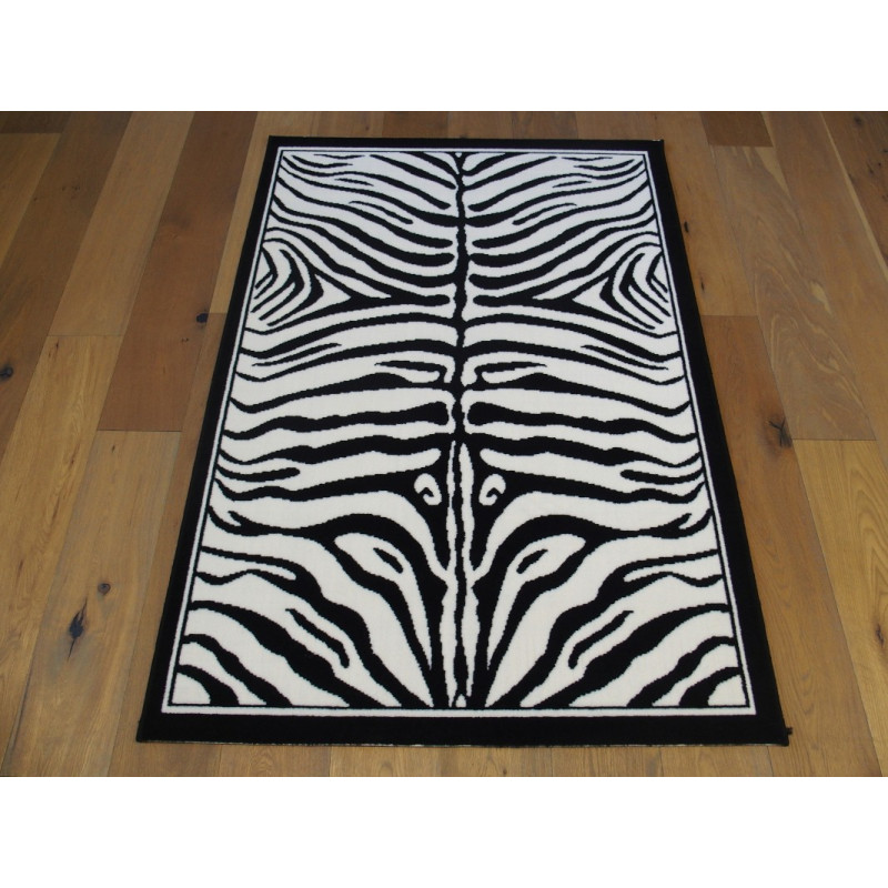 tapis zebre noir et blanc. Black Bedroom Furniture Sets. Home Design Ideas